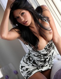 Jasmine Foxx pops right out of her black and white mini skirt