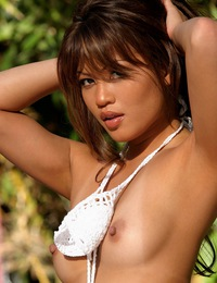 Charmane Star is a tanned Asian beauty in a white bikini