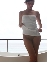 Caprice,Hot Bath,Gorgeous Caprice strips out of her tiny white dress and masturbates in the bath with a glass toy.